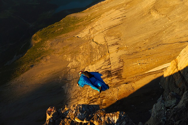 A colorful kite sitting on top of a mountain