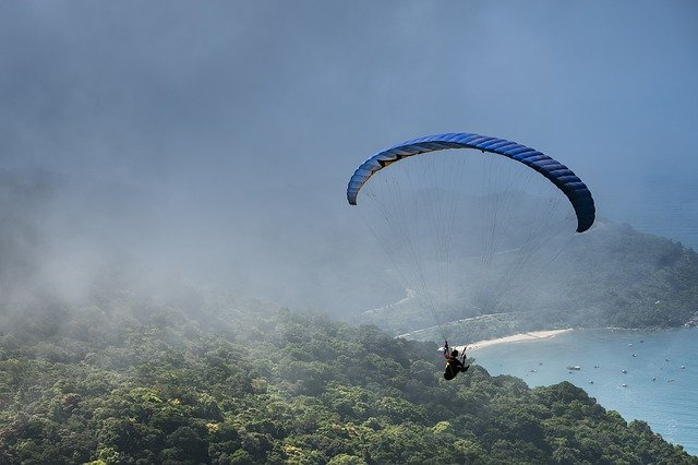 A parachute in the air over a body of water